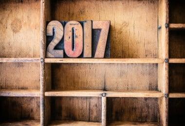 The word 2017 written in vintage wooden letterpress type in a wooden type drawer.